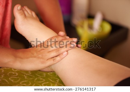 An obese girls feet getting massaged by her local beautician, at her spa day out