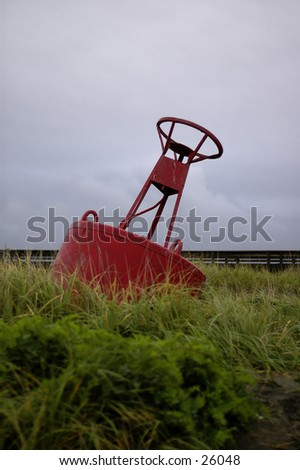 An ocean bouy on dry land - stock photo