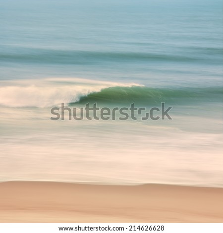 An ocean seascape with blurred panning motion.  Image displays soft desaturated colors with cross-processing. - stock photo
