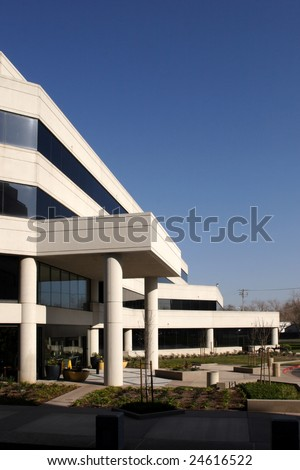 An office building with a empty parking lot