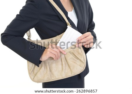 An office lady who carrying shoulder bag