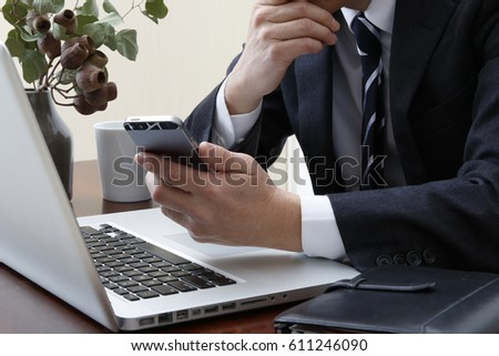 An office worker uses the smartphone