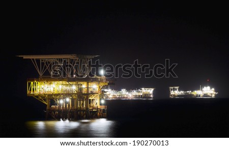 An offshore oil-platform at night