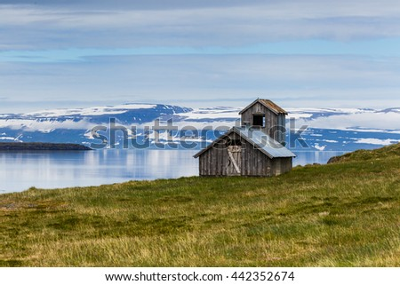 An old abandon house at a fjord in Iceland - stock photo