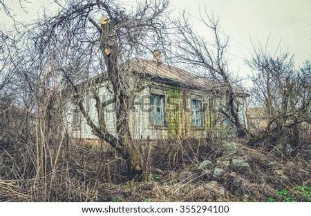 An old abandoned house.  Death in poverty and loneliness - stock photo