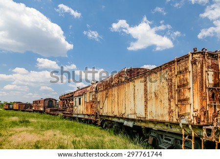 An old abandoned railroad train on tracks - stock photo