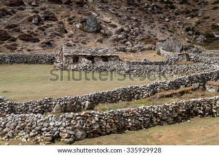 An old abandoned stone house high in the Himalayan mountains, Everest region, Nepal - stock photo