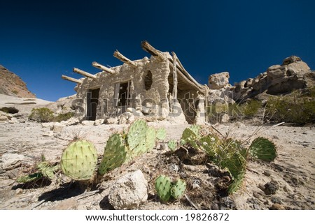 An old adobe hut used by the natives now sits abandoned in the desert, near Terlingua, Texas. - stock photo