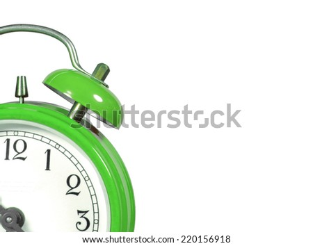 an old alarm clock old green - stock photo