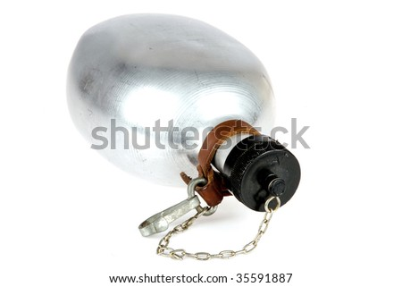 an old aluminium flask, isolated on a white background