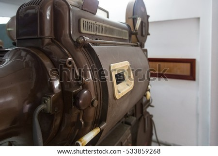 An old analog movie projector from behind