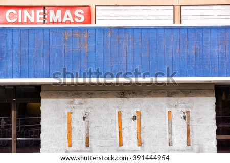 An old and outdated cinema movie theatre shows signs of it being closed and abandon.  - stock photo