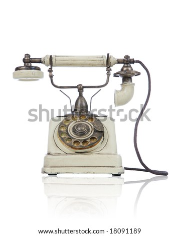 An old antique retro phone over white background - stock photo