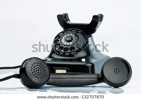 an old antique telephone. isolated and released on a white background - stock photo