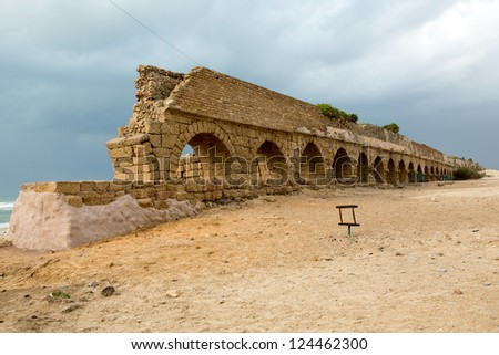 An old aqueduct in the city Ceasaria in Israel - stock photo