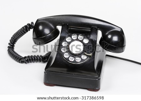 An old bakelite dial phone. - stock photo