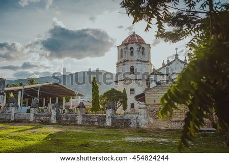 An old baroque church in the Oslob, Philippines. Our Lady of the Immaculate Conception catholic Church at Oslob in Cebu, Philippines. Beautiful place of rest. Park at sunset in summer. - stock photo