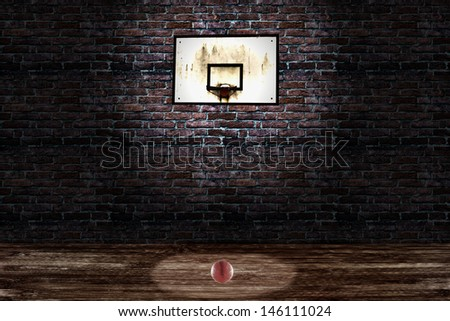 An old basket and a basketball in a playground - stock photo