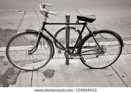 An old bicycle locked up on the street in Toronto