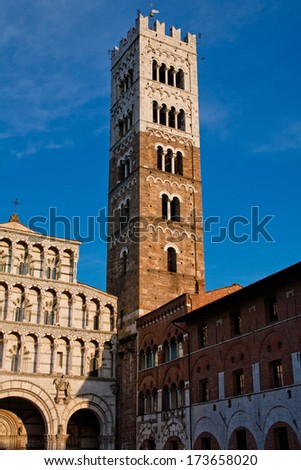 An old big medieval tower in Lucca   - stock photo