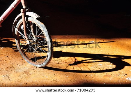 an old bike and its reflection - stock photo