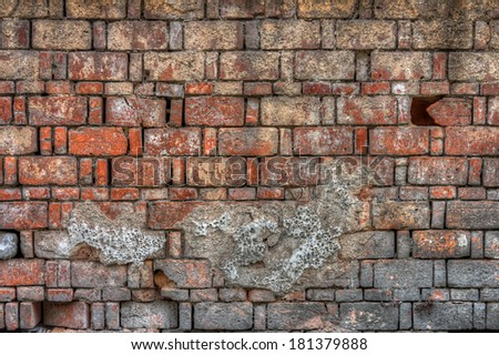 An old block brick wall - stock photo