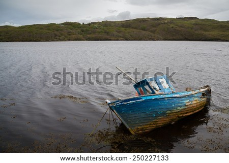 An old boat in a lake in Donegal