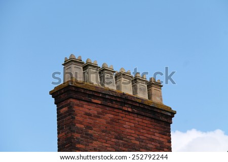 An Old Brick Building with Six Square Chimneys. - stock photo