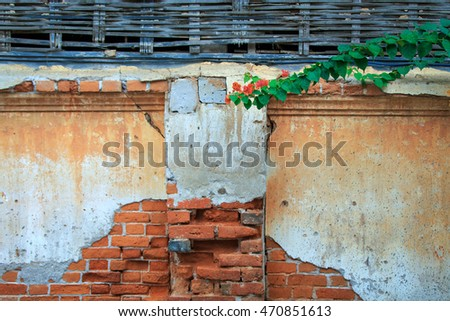 An old brick wall of an abandoned house