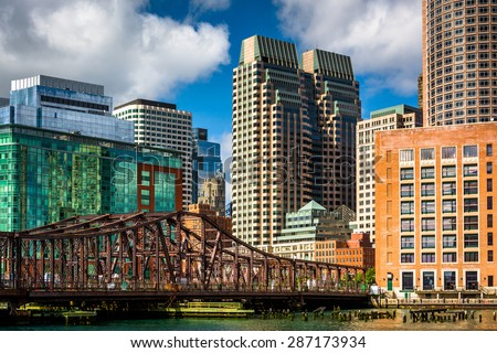 An old bridge over Fort Point Channel and buildings in Boston, Massachusetts. - stock photo