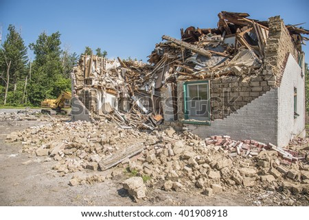 An old building made of mud bricks is partially demolished in Stouffville Ontario Canada.