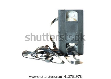 An old cassette with the tape coming out on white background. - stock photo