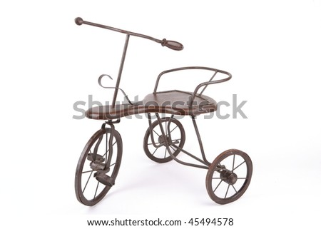 an old cast iron tricycle - stock photo
