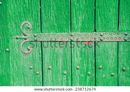 An old castle gate with rusty door hinge. - stock photo