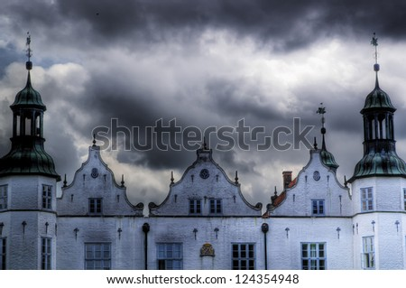 An old castle in Germany during a thunderstorm. - stock photo