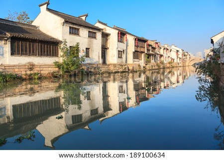 An old Chinese traditional town by the Grand canal,suzhou,jiangsu,China.Grand canal is oneof  famous and oldest canal in the world, it is a famous tourist destination for it's classical gardens. - stock photo