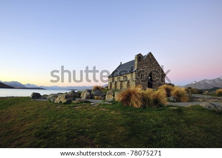 An old church in front of lake tekapo, south island, new zealand