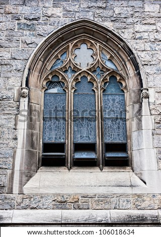 An old church window showing much detail and texture - stock photo