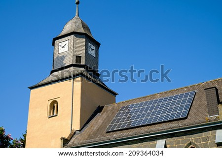 An old church with solar panels on the roof - stock photo