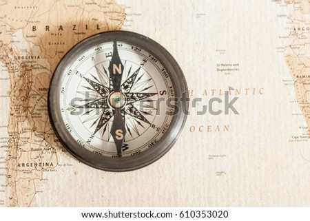 Old compass on vintage world map stock photo royalty free an old compass on vintage world map compass on map background close up gumiabroncs Image collections