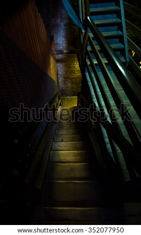 An Old, Dangerous Wooden Staircase Leads To The Dark Dungeon