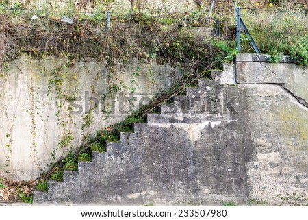 An old decaying stairwell - stock photo