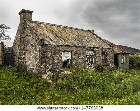 an old derelict house in the mournes - stock photo