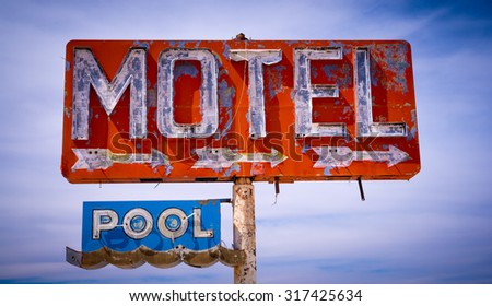 An old dicrepit, flaking neon motel sign in the American Desert - stock photo
