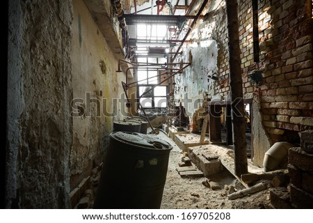 an old dilapidated industrial interior, poor light