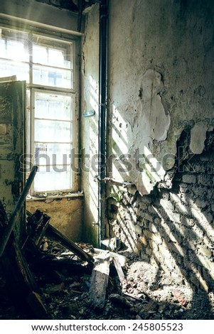 An old dilapidated room where the sun shine through the window