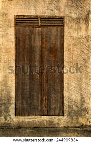 An old door in Guadeloupe - stock photo