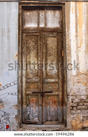 An old door of abandoned house in Tel Aviv