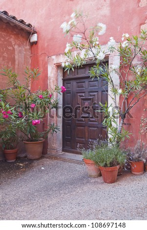 An old doorway in the village of Roussillon in Provence. - stock photo