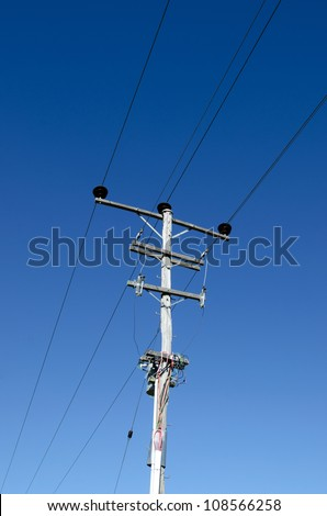 An old electricity power line transformers. - stock photo
